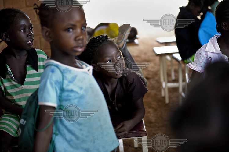 A group of children at the Opera Village. This project, begun by the late German film director and artist Christoph Schlingensief, established an arts village containing educational, sports, social and performing arts facilities in rural Burkina Faso.