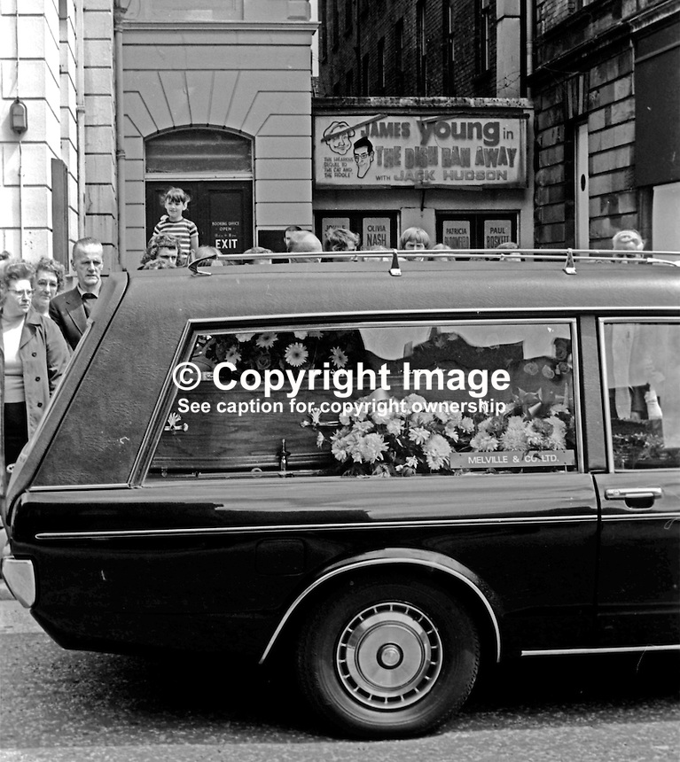 Funeral of N Ireland comedian James Young, 9th July 1974.  The hearse passes the entrance to the Group Theatre still advertising his last show. 197407090382e<br /> <br /> Copyright Image from Victor Patterson, 54 Dorchester Park, Belfast, UK, BT9 6RJ<br /> <br /> t1: +44 28 9066 1296<br /> t2: +44 28 9002 2446<br /> m: +44 7802 353836<br /> <br /> e1: victorpatterson@me.com<br /> e2: victorpatterson@gmail.com<br /> <br /> www.victorpatterson.com<br /> <br /> IMPORTANT: Please see my Terms and Conditions of Use at www.victorpatterson.com