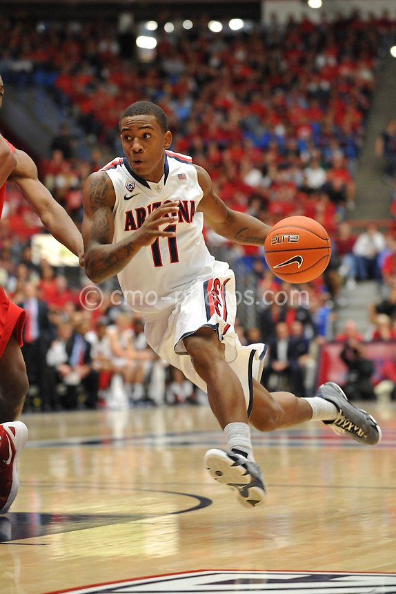 Nov 23, 2011; Tucson, AZ, USA; Arizona Wildcats guard Josiah Turner (11) drives into the lane in the first half of a game against the San Diego State Aztecs at the McKale Center.  Mandatory Credit: Chris Morrison-US PRESSWIRE