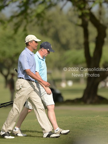 President Barack Obama, left, walks with Prime MInister John Key of New Zealand, right, near the 2nd green at the Marine Corps Base Hawaii's Kaneohe Klipper Golf Course, Kaneohe, Hawaii, January 2, 2014. <br /> Credit: Cory Lum / Pool via CNP