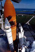 A diversified mission of astronomy, commercial space research and International Space Station preparation gets underway as the Space Shuttle Columbia climbs into orbit from Launch Pad 39B at the John F. Kennedy Space Center at Cape Canaveral, Florida at 2:55:47 p.m. EST, November 19, 1996.  During Mission STS-80, Columbia's five-person crew will deploy and retrieve two free-flying spacecraft, conduct two spacewalks and perform a variety of microgravity research experiments in the shuttle's middeck area.  The two primary payloads for STS-80 are the Wake Shield Facility-3 (WSF-3) and the Orbiting and Retrievable Far and Extreme Ultraviolet Spectrometer-Shuttle Pallet Satellite II (ORFEUS-SPAS II). STS-80 marks the 21st flight for Columbia and the 80th mission in Shuttle program history.<br /> Credit: NASA via CNP
