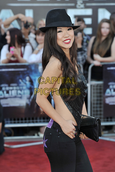 SELINA LO.UK Premiere of 'Cowboys and Aliens' at the Cineworld cinema at the O2 Arena, London, England..August 11th 2011.half length black hat top cloth sequins sequined clutch bag hand on hip side.CAP/MAR.© Martin Harris/Capital Pictures.