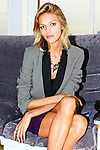 Anja Rubik poses with arms a legs crossed. Photographed during Yoga for Wii video game launch, 463 West Street, Ramscale Loft, November 9 2009.