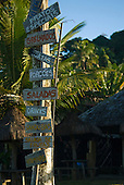 Praia da Tiririca, Itacare, Bahia State, Brazil. Beach restaurant menu painted on wooden shingles.