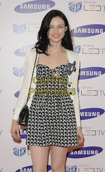 SOPHIE ELLIS BEXTOR.The Samsung 3D TV launch party, Saatchi Gallery, London, England..April 27th, 2010.half length black white dress cardigan chanel bag bow bows print .CAP/CAN.©Can Nguyen/Capital Pictures.