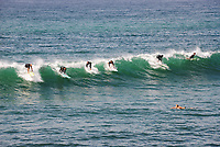 Surfing in Huntington Beach at the Pier