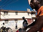 Moto-taxis are the predominant mode of transportation within Jacmel, Haiti.