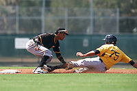 Pittsburgh Pirates second baseman Adrian Valerio (59) tags out Cole Tucker (75) sliding into second base during an Instructional League Intrasquad Black & Gold game on September 21, 2016 at Pirate City in Bradenton, Florida.  (Mike Janes/Four Seam Images)