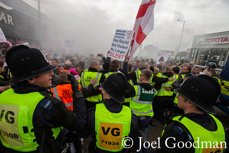 © Joel Goodman - 07973 332324 . 05/05/2012 .  Luton , UK . A smoke bomb is set off in the crowd . Approximately 1,500 people take part in an EDL ( English Defence League ) march in Luton , understood to have been policed by over 1,000 officers . Photo credit: Joel Goodman