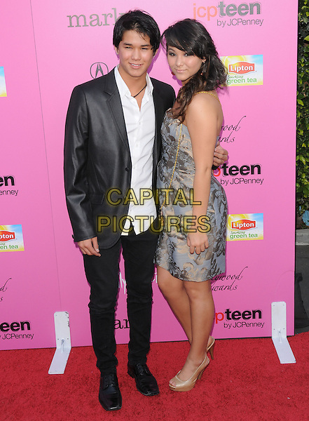 BOOBOO & FIVEL STEWART.The 12th Annual Young Hollywood Awards held at The Wilshire Ebell Theatre  in Los Angeles, California, USA..May 13th, 2010.full length jacket top dress blue grey gray side brother family sister siblings black pattern.CAP/RKE/DVS.©DVS/RockinExposures/Capital Pictures.