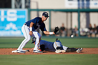Lakeland Flying Tigers second baseman Anthony Pereira (9) waits to receive a throw as Tyler Gaffney (6) slides into second base during the first game of a doubleheader against the Bradenton Marauders on April 11, 2018 at Publix Field at Joker Marchant Stadium in Lakeland, Florida.  Lakeland defeated Bradenton 5-4.  (Mike Janes/Four Seam Images)