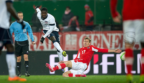 19.11.2013. Vienna, Austria.  USA's Eddie Johnson in action against Austria's Florian Klein (R) during the international soccer friendly match between Austria and USA at Ernst-Happel Stadium in Vienna, Austria, 19 November 2013.