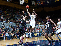 December 29th, 2012: California's Tyrone Wallace shoots for the basket during a game against Harvard at Haas Pavilion in Berkeley, Ca Harvard defeated California 67 - 62