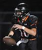 Joe Rende #10, Babylon quarterback, scrambles for a gain during a Suffolk County Division IV varsity football game against Glenn at Babylon High School on Friday, Oct. 6, 2017.