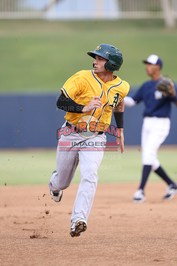 Luis Barrera (18) of the AZL Athletics runs the bases during a game against the AZL Brewers at Maryvale Baseball Park on June 30, 2015 in Phoenix, Arizona. Brewers defeated Athletics, 4-2. (Larry Goren/Four Seam Images)