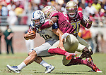 Florida State Derwin James tackles Charleston Southern quarterback Robert Mitchell as FSU's Trey Marshall moves in during the first half of Florida State's 52-8 win over Charleston Southern in their NCAA football game at Doak Campbell Stadium in Tallahassee Florida September 10, 2016.