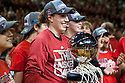 March 9, 2014: Nebraska Jordan Hooper holding the Big Ten Championship trophy that the women's team earned earlier that same day in Indianapolis, Indiana during a time out in the men's game against the Wisconsin Badgers at the Pinnacle Bank Arena, Lincoln, NE. Nebraska 77 Wisconsin 68.