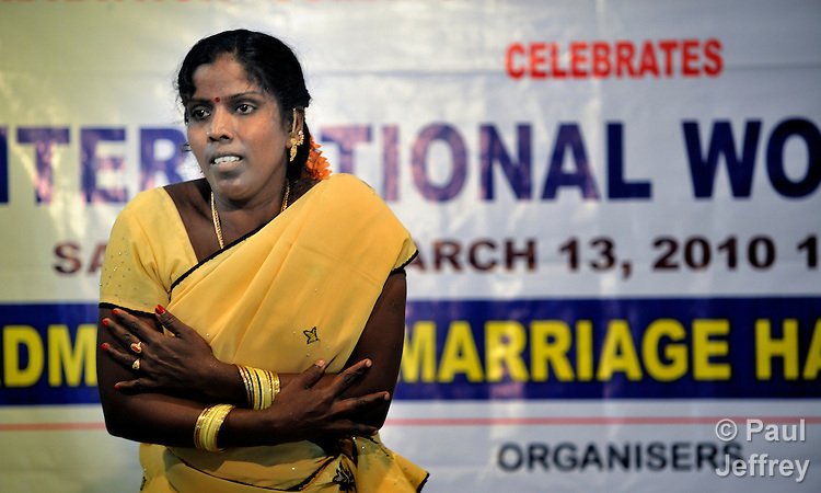 A woman dancing during a celebration of International Women's Day in the village of Kundrathur Somangalam in southern India's state of Tamil Nadu.