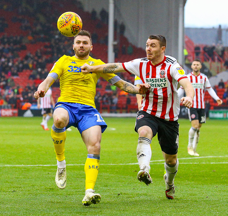 Leeds United's Stuart Dallas holds off the challenge from Sheffield United's John Fleck<br /> <br /> Photographer Alex Dodd/CameraSport<br /> <br /> The EFL Sky Bet Championship - Sheffield United v Leeds United - Saturday 1st December 2018 - Bramall Lane - Sheffield<br /> <br /> World Copyright © 2018 CameraSport. All rights reserved. 43 Linden Ave. Countesthorpe. Leicester. England. LE8 5PG - Tel: +44 (0) 116 277 4147 - admin@camerasport.com - www.camerasport.com
