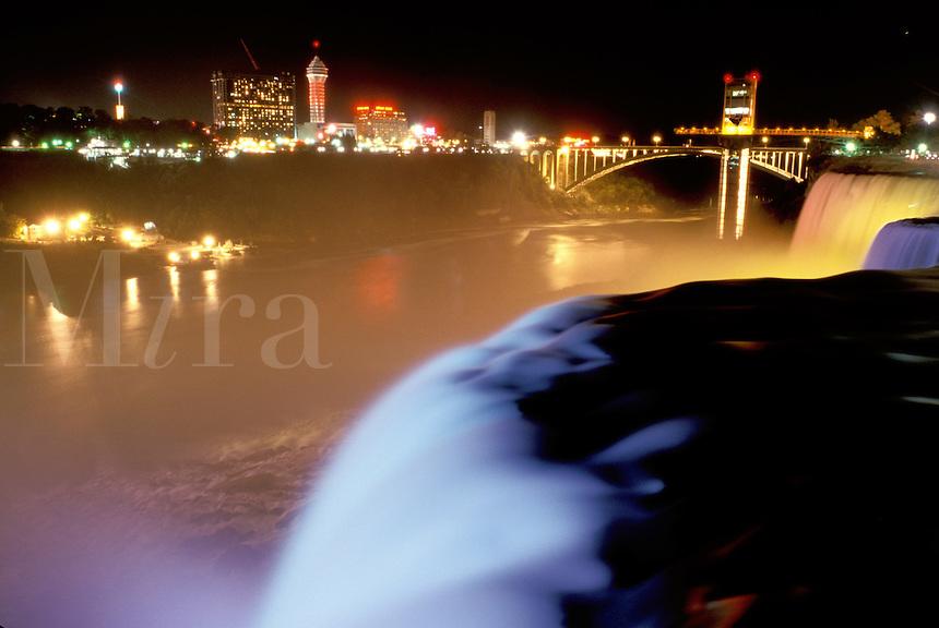 Niagara Falls, New York, NY, waterfall, American Falls illuminated at night at Niagara Falls.