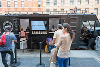 Samsung owners on line for service at a pop-up trailer for Fashion Week outside the Samsung 837 showroom in the Meatpacking District in New York on Thursday, September 8, 2016. The batteries in Samsung Electronics' Galaxy Note 7 smartphones apparently can catch fire while charging precipitating a ban on charging them on several airlines and an obligatory recall. (© Richard B. Levine)