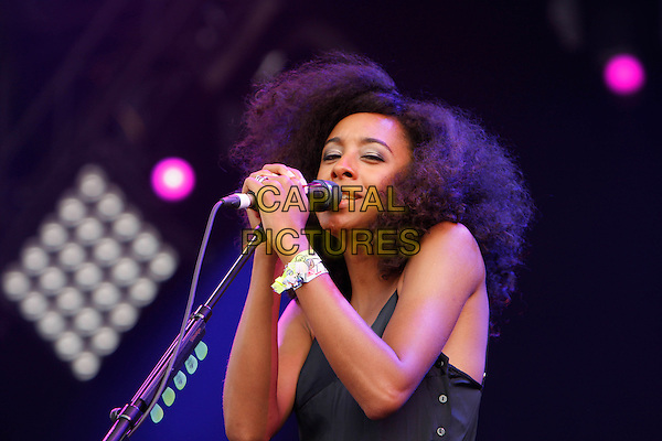 CORINNE BAILEY RAE .Performs at Hyde Park Calling - Day 2, London, England, UK, 26th June 2010..live music gig on stage festival concert.half length microphone black catsuit pantsuit buttons singing.CAP/MAR.©Martin Harris/Capital Pictures.