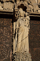 Virgin with Child standing on the trumeau, Portal of the Virgin, 1210 - 1220, Notre Dame de Paris, 1163 ? 1345, initiated by the bishop Maurice de Sully, Ile de la Cité, Paris, France. Destroyed by the revolution in 1793 and restored in the 19th century by Viollet-le-Duc. Picture by Manuel Cohen