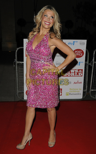 MELINDA MESSENGER .At the Children's Champions Awards 2010, Grosvenor House Hotel, Park Lane, London, England, UK, .March 3rd 2010..arrivals full length pink dress jewel encrusted silver jewelled sparkly embellished dress beige cream peep toe platform shoes heels halterneck beaded hand on hip .CAP/CAN.©Can Nguyen/Capital Pictures.