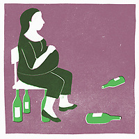Pregnant woman surrounded by wine bottles ExclusiveImage