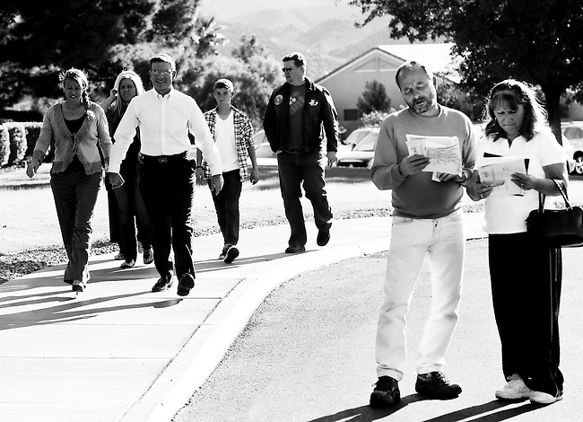 Joe Heck arrives with his family to vote at the Desert Willows Golf Course in Henderson, Nev., on election day, Nov. 2, 2010, as voters look look over the sample ballots outside of the polling place. (Photo By Bill Clark/Roll Call)