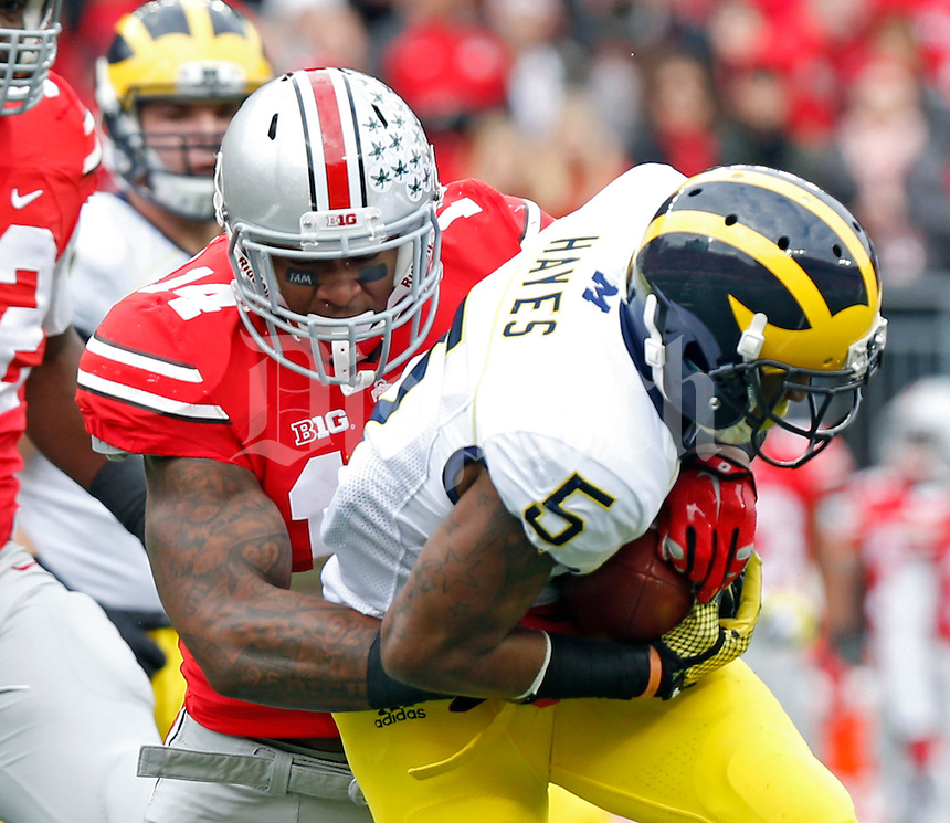 Ohio State Buckeyes linebacker Curtis Grant (14) against Michigan Wolverines at Ohio Stadium in Columbus, Ohio on November 29, 2014.  (Dispatch photo by Kyle Robertson)