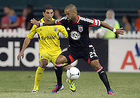 WASHINGTON, DC - AUGUST 4, 2012:  Maicon Santos (29) of DC United shields the ball from Carlos Mendes (4) of the Columbus Crew during an MLS match at RFK Stadium in Washington DC on August 4. United won 1-0.