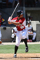 Jake Kahaulelio #3 of the Carolina Mudcats hitting during a game against the Montgomery Biscuits on April 18, 2010 in Zebulon, NC.