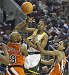 Seattle SuperSonics Ray Allen ,center, looks to pass the ball off while being guarded by  Los Angeles Clippers Sam Cassell,left, and Shaun Livingston in the third period on Friday, April 14, 2006 at the Key Arena in Seattle. The Clippers beat the SuperSonics 101-97.  Jim Bryant Photo. ©2010. All Rights Reserved.