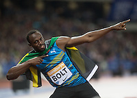 Usain BOLT of Jamaica (Men's 100m) poses for the cameras during the Sainsburys Anniversary Games Athletics Event at the Olympic Park, London, England on 24 July 2015. Photo by Andy Rowland.