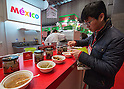 March 3, 2015, Chiba, Japan - A picture released on March 4, 2015 shows a visitor trying samples of salsa on a tortilla chip at the Mexico booth area during the 40th annual International Food and Beverage Exhibition (FOODEX JAPAN 2015). Some 2,977 exhibitors from 79 nations participate in what is known to be the largest food and beverage exhibition in Asia. 75,000 buyers which include wholesalers, food service companies, and distributors are expected to attend FOODEX which runs from March 3-6. (Photo by AFLO)