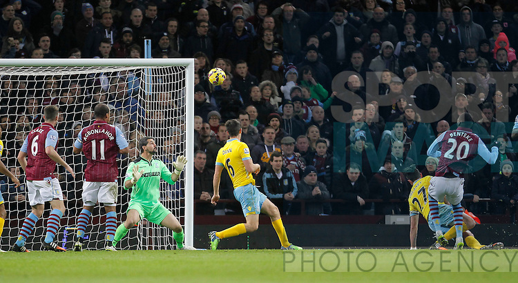 Christian Benteke of Aston Vila misses the best chance of the game, shooting over the bar - Barclays Premiership Football - Aston Villa v Crystal Palace - Villa Park  Birmingham - Season 14/15 - 01/01/2015 <br /> Photo: Malcolm Couzens/Sportimage