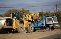 Pictured: A digger loads soil onto a tipper lorry at the second site in Kos, Greece. Thursday 13 October 2016<br />
