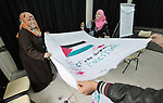 Young women in Gaza participate in a group activity at the Alassria Cultural Center (or Al-Asryia)in the Jabalya refugee camp in the Gaza Strip. The center is supported by the American Friends Service Committee, a Quaker organization from the United States. One the fabric they have drawn a Palestinian flag...