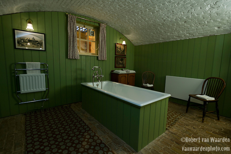 The bathroom of the Queen Anne's Summerhouse on the Shuttleworth estate at Old Warden, Bedfordshire, the United Kingdom. Queen Anne's Summerhouse is a building belonging to the Landmark Trust, a United Kingdom building preservation charity that rescues historic buildings at risk and gives them a new life as places to stay in and experience.