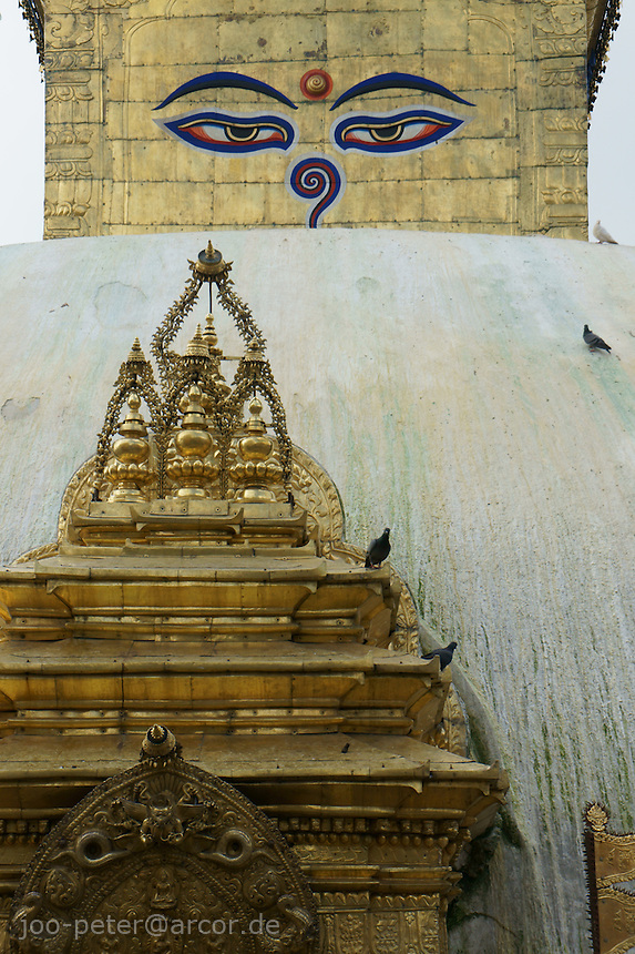 close-up of stupa, buddhist temple Swayambhu in Kathmandu, Nepal, September 2011. The eyes painted on the golden top are Buddhas eyes called Adi-Buddha, together with urna, a spiral form symbolizing light.