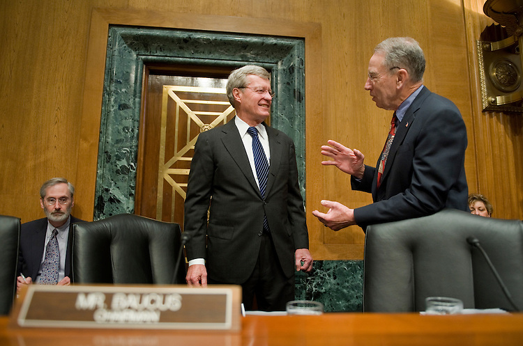 """Chairman of the Senate Finance Committee Max Baucus, D-Mont., left, talks with ranking member Sen. Charles Grassley, R-Iowa, before a hearing entitled """"The President's Proposed Fee on Financial Institutions Regarding TARP,"""" April 20, 2010.  The hearing featured testimony from Neil Barofsky, Treasury Special Inspector General of Troubled Asset Relief Program (TARP)."""