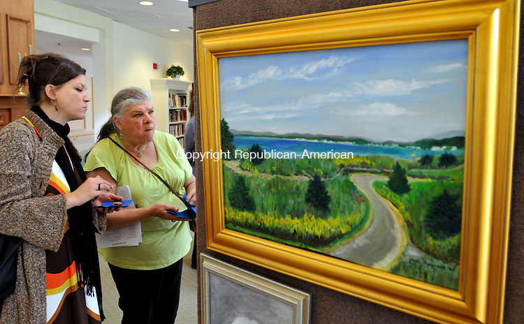 SOUTHBURY, CT, 25 SEPTEMBER 2011-092511JS17-- FOR COUNTRY LIFE USE ONLY--Christina Yunckes of Newtown and her mother Muriel Ridener, also of Newtown, look over paintings during the Pomperaug Woods fourth annual juried art show in Southbury on Sunday. All of the 215 pieces of artwork are from artists throughout the state that are 70 years-old and over. <br /> Jim Shannon Republican-American