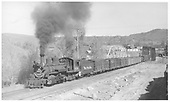 Pilot-end fireman's-side view of leased D&amp;RGW #459 crossing the Animas River on Bridge 451-A with a northbound freight.<br /> RGS  Durango, CO  Taken by Perry, Otto C. - 10/17/1941