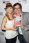 Kelli O'Hara and Seth Rudetsky attends the Seth Rudetsky Book Launch Party for 'Seth's Broadway Diary' at Don't Tell Mama Cabaret on October 22, 2014 in New York City.