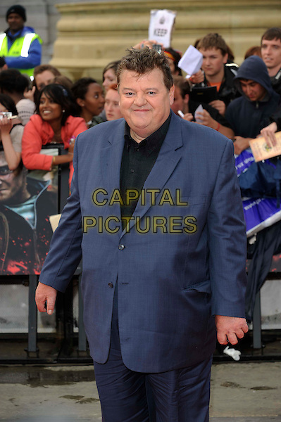 Robbie Coltrane.'Harry Potter and the Deathly Hallows - Part 2' world film premiere arrivals Trafalgar Square, London, England 7th July 2011.HP7 half length blue suit black shirt  .CAP/DH.©David Hitchens/Capital Pictures.