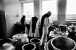 Monks working in the kitchen at Sancta Maria Abbey at Nunraw, East Lothian, home since 1946 to the Order of Cistercians of the Strict Observance. Around 15 monks were resident at Nunraw in 1996, undertaking a mixture of daily tasks and strict religious observance. The present purpose-built building dates from 1969 when the monks moved from the nearby Nunraw house.