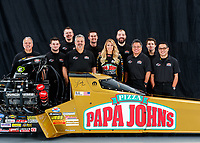 Jan 9, 2018; Brownsburg, IN, USA; NHRA top fuel driver Leah Pritchett poses for a portrait with crew members during a photo shoot at Don Schumacher Racing. Mandatory Credit: Mark J. Rebilas-USA TODAY Sports
