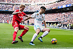 Marco Asensio of Real Madrid (R) in action against Simon Kjaer of Sevilla FC (L) during the La Liga 2017-18 match between Real Madrid and Sevilla FC at Santiago Bernabeu Stadium on 09 December 2017 in Madrid, Spain. Photo by Diego Souto / Power Sport Images