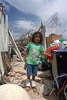 Quintana Roo, Mexico. Thursday, August 23, 2007. Three year old Valeria helps her family sift through the the debris of her home.  The town of Mahahual was where category 5 Hurricane Dean first made landfall in Mexico, with winds of 300km/h it was where most of the damage was suffered.